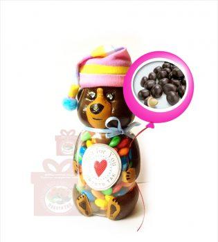 "Баночка ""Ведмедик"" наповнена цукерками ""Арахіс в какао""."